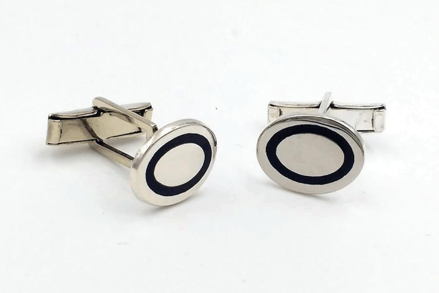 Plain oval cufflinks with black line